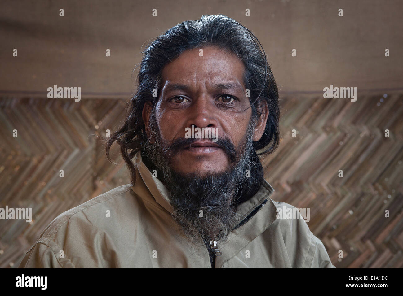 Portrait of a local man at the Kumbh Mela 2013 in Allahabad, India - Stock Image