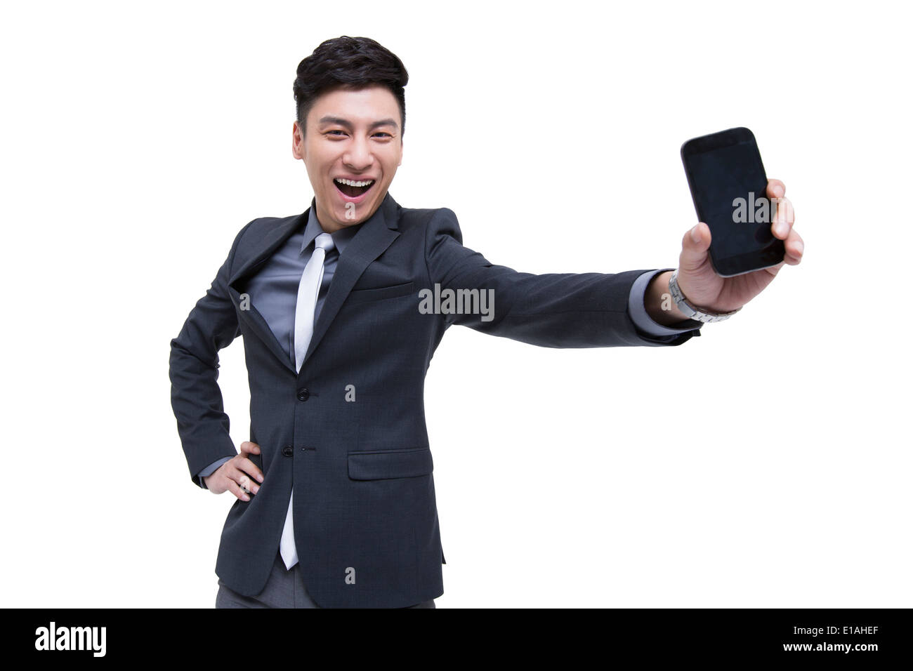 Cheerful businessman being proud of his smart phone - Stock Image