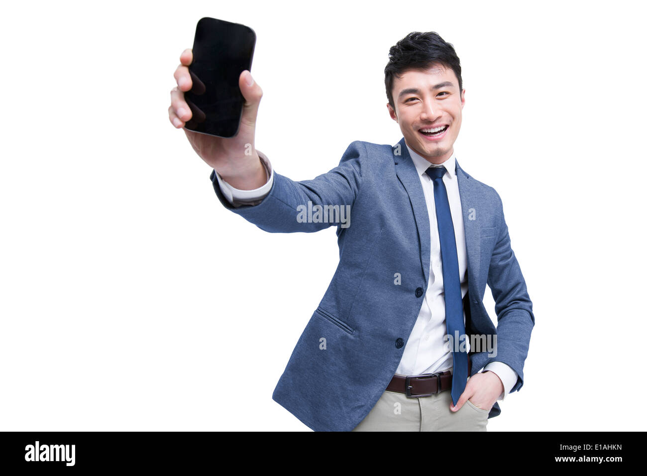 Young businessman with smart phone Stock Photo