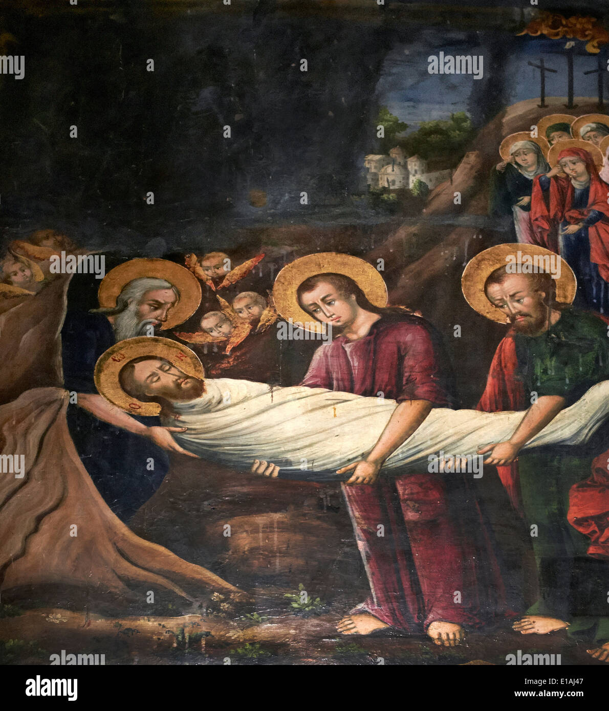 Jesus Christ being laid to rest after his crucifixion - Stock Image