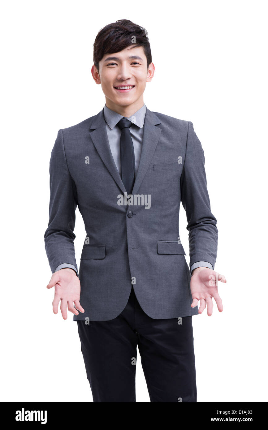 Young businessman shrugging - Stock Image