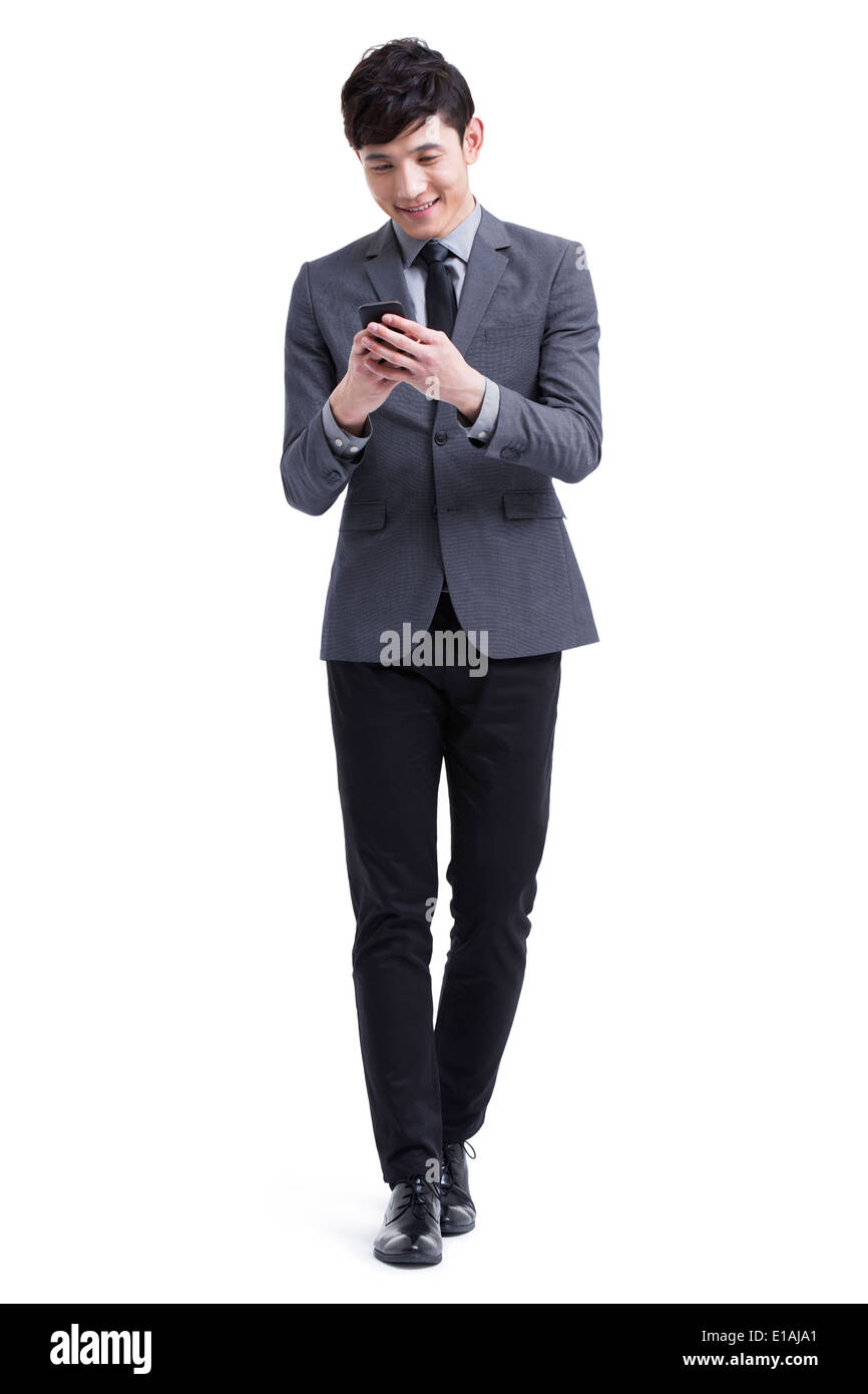 Young businessman with smart phone - Stock Image