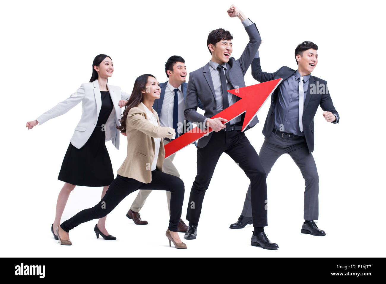 Fashionable businessperson punching the air with red arrow sign - Stock Image