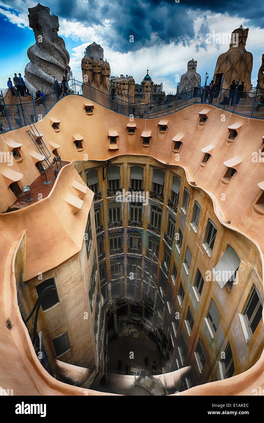 Rooftop View of Casa Mila (La Pedrera) With Group of Chimneys and Courtyard, Barcelona, Catalonia, Spain - Stock Image