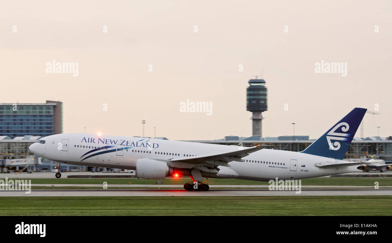 Air New Zealand Boeing 777-200ER (ZK-OKG) plane wide-body commercial jetliner taking off from Vancouver International Airport - Stock Image