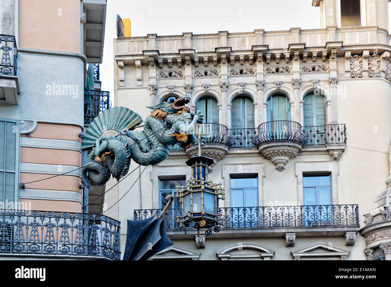 Chinese Dragon Sculpture on the Walls of a House Decorated with Umbrellas,  Bruno Quadras Building, Las Ramblas, Barcelona - Stock Image