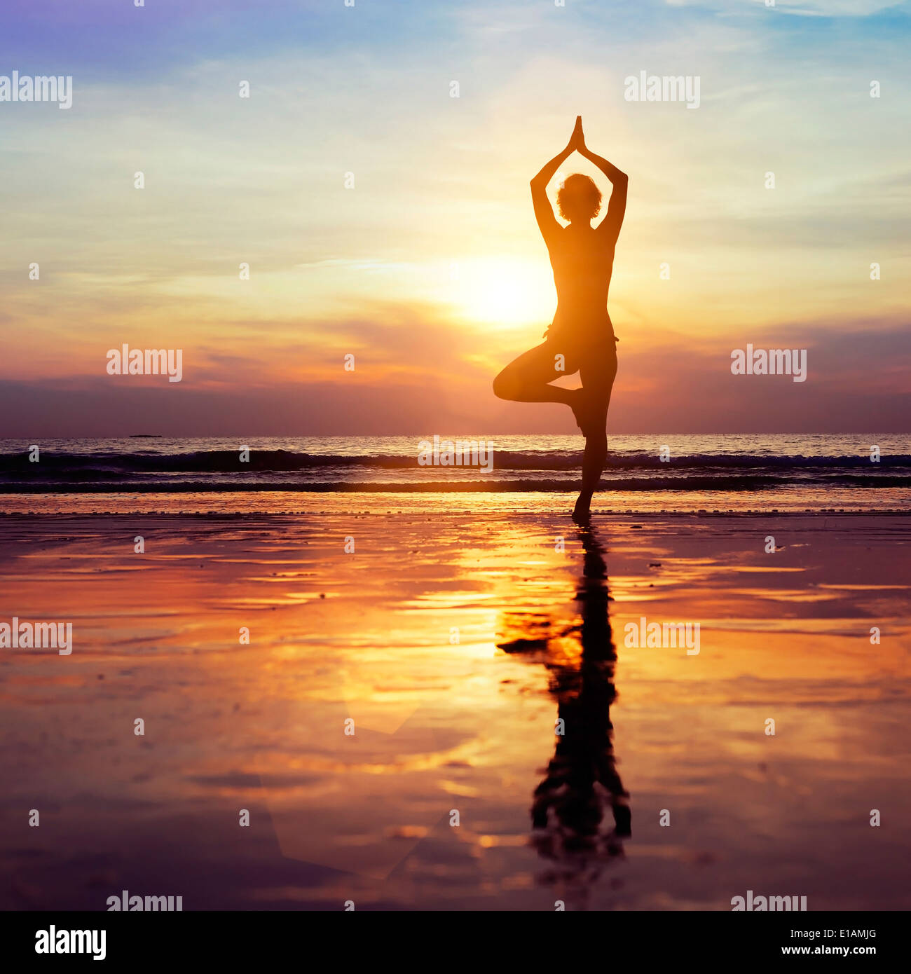 yoga on the beach, healthy lifestyle concept - Stock Image