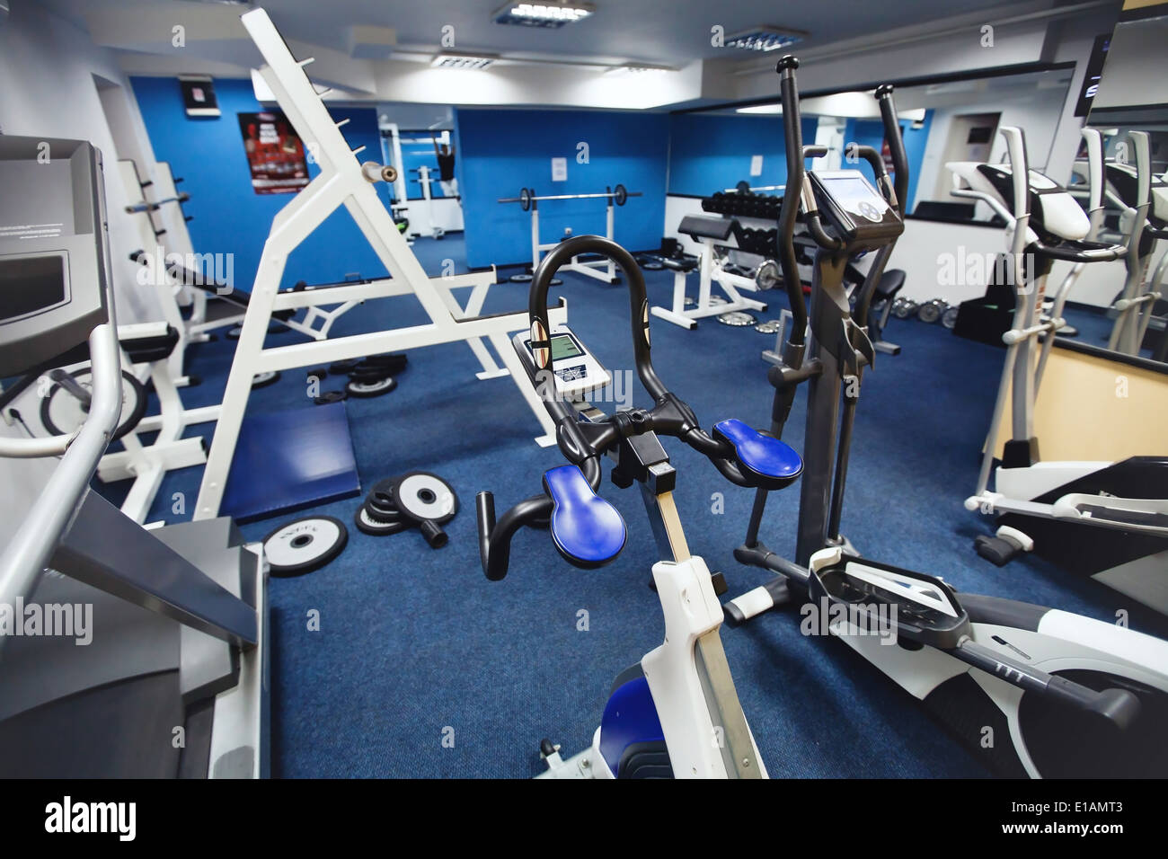 interior of fitness center, training on the bicycle - Stock Image