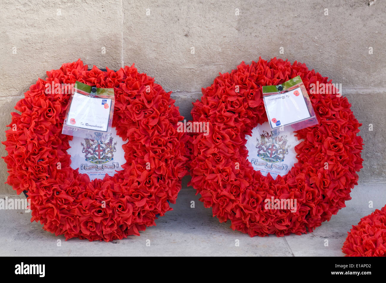 Poppy Wreaths on a gate outside 10 Downing Street London England - Stock Image