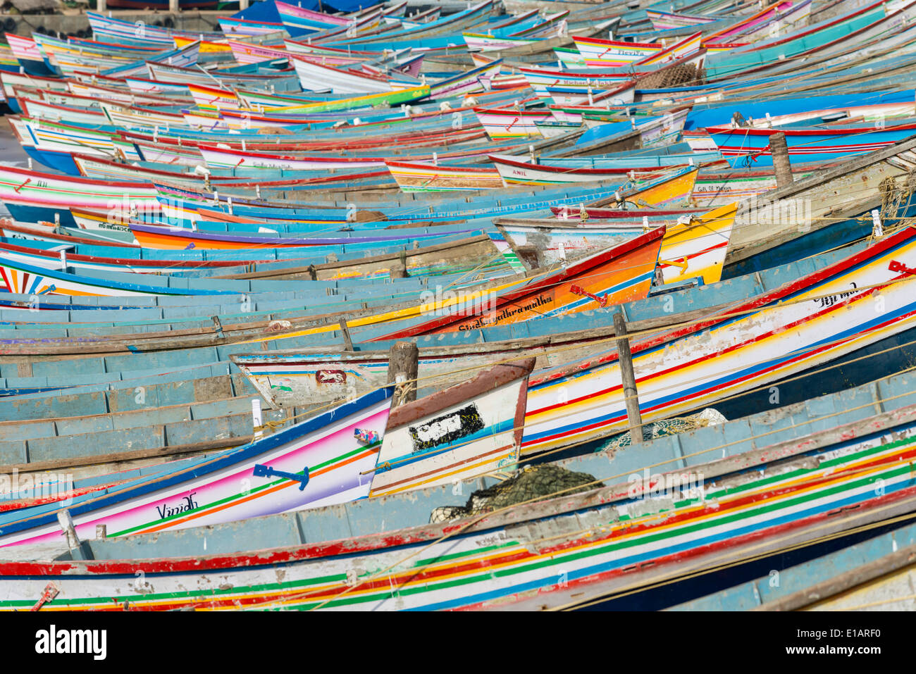 Colorful fishing boats in the harbour, Vizhinjam, Kerala, India - Stock Image