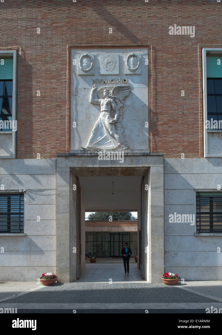 Town Hall, portal with a relief of the goddess of victory, Italian Rationalism, Sabaudia, Lazio, Italy - Stock Image