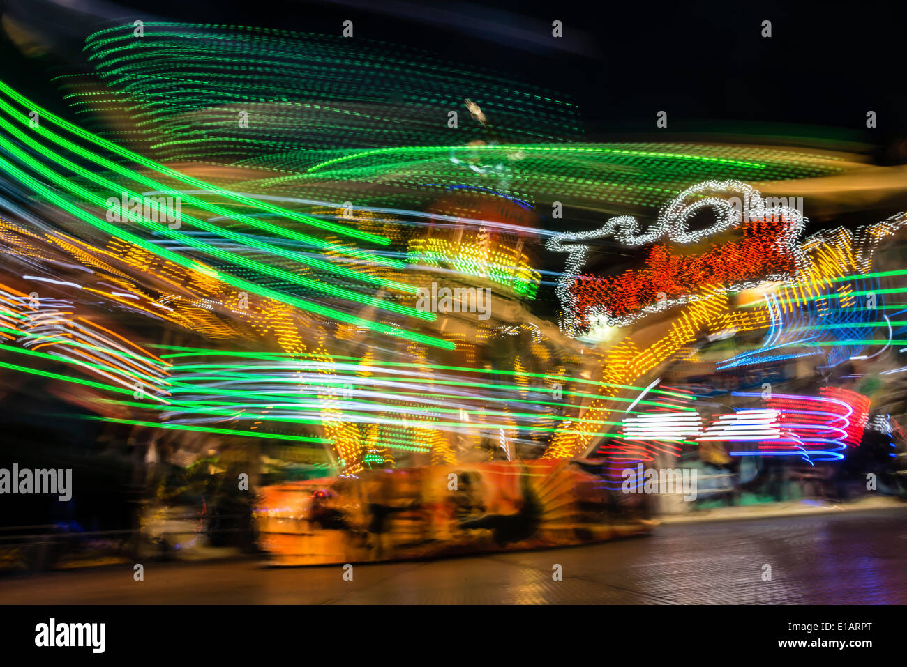 Light trails, ride at night, Munich Spring Festival, Theresienwiese, Munich, Bavaria, Germany - Stock Image