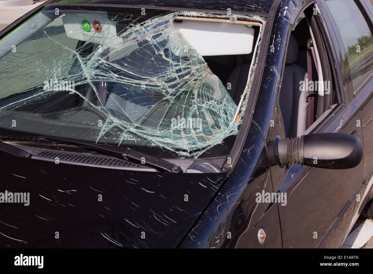 Black compact car with an accident-damaged windshield, Hungary - Stock Image