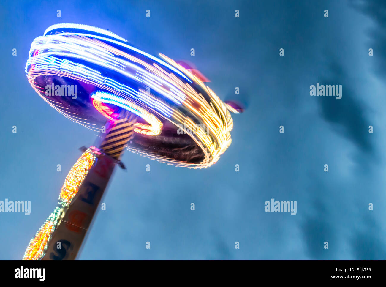 Ride at night, light trails, Munich Spring Festival, Theresienwiese, Munich, Bavaria, Germany - Stock Image