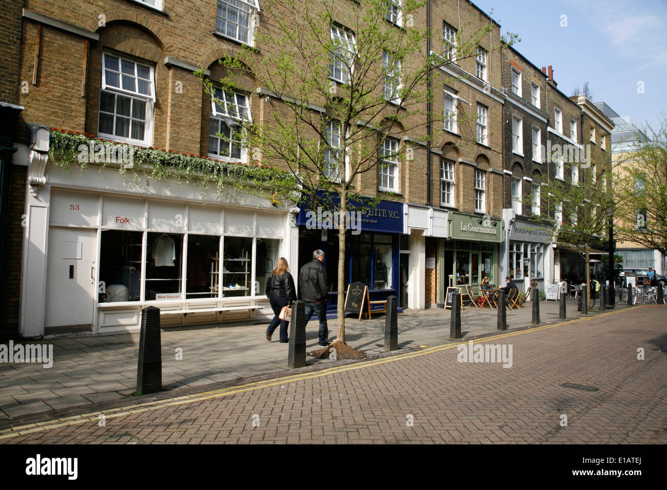 Folk and Private White VC gents outfitters on Lamb's Conduit Street, Bloomsbury, London, UK - Stock Image