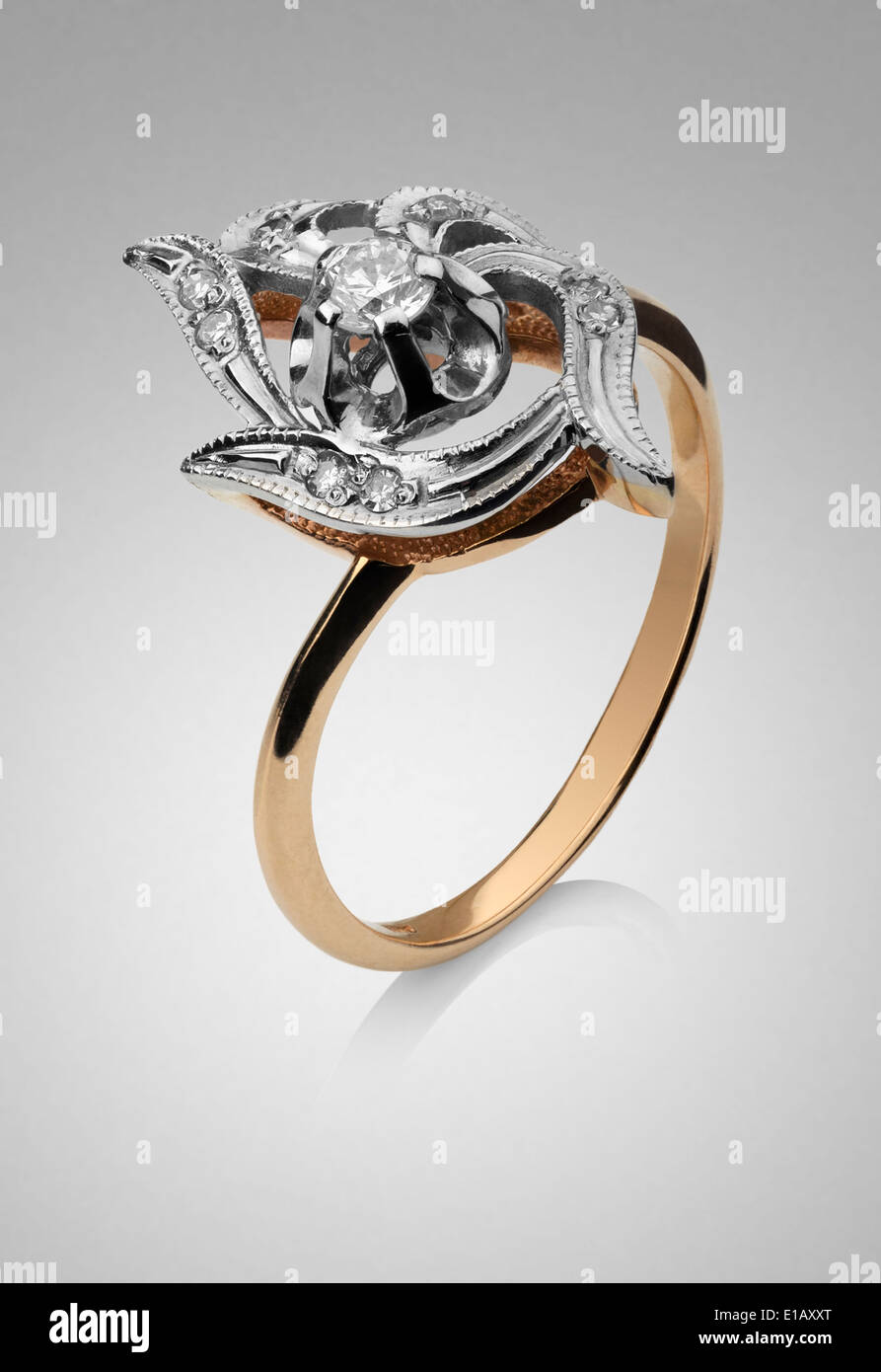 Women's gold ring with platinum and diamond gems - Stock Image