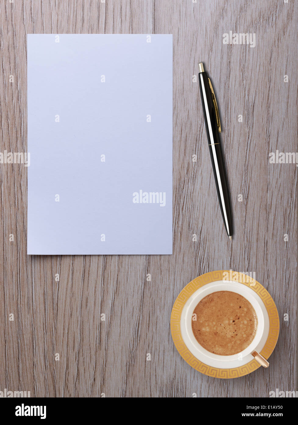 white blank sheet of paper with pen and cup of coffee on your desktop - Stock Image