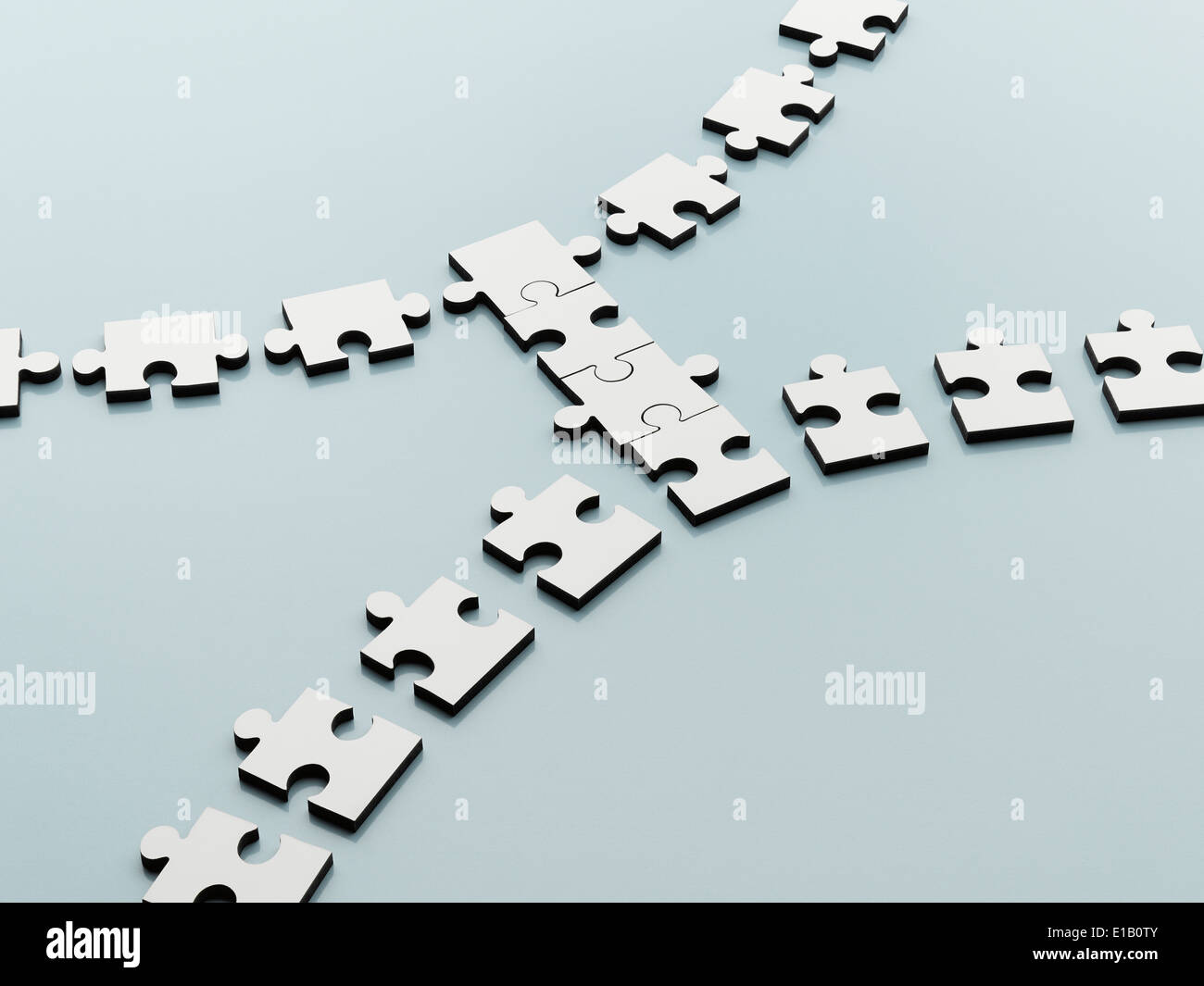Jigsaw pieces bridging the gap Stock Photo