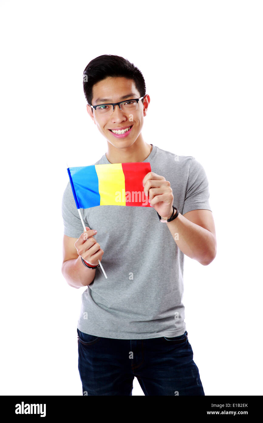 Cheerful young asian man holding flag of Romania isolated on white background - Stock Image