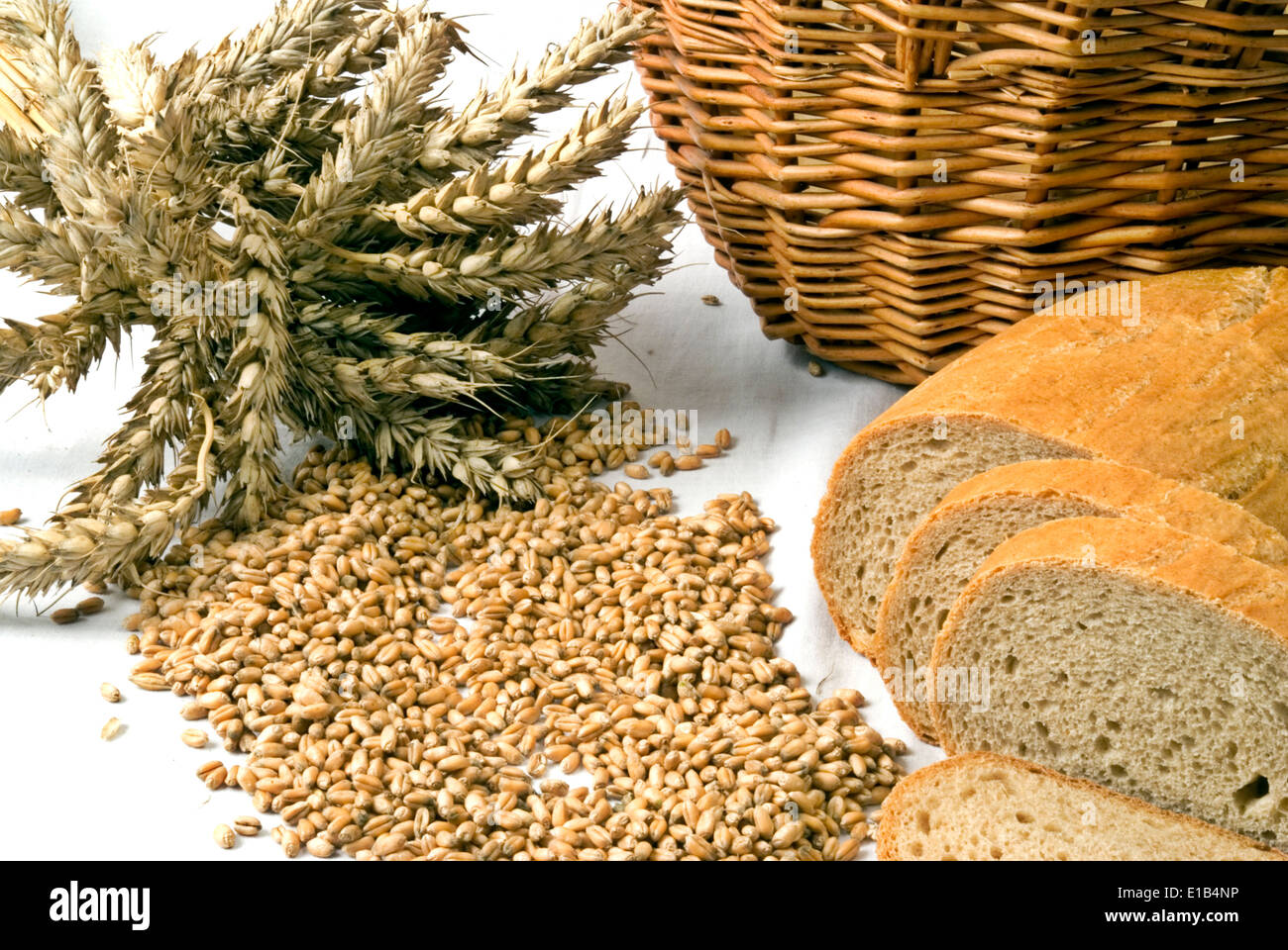 Bread with grain and basket isolated on white - Stock Image