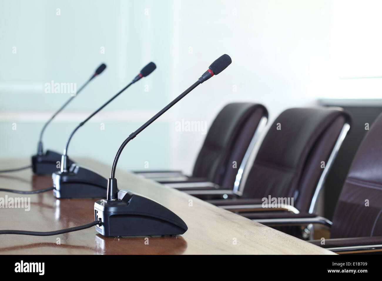 Conference microphones in a meeting room - Stock Image