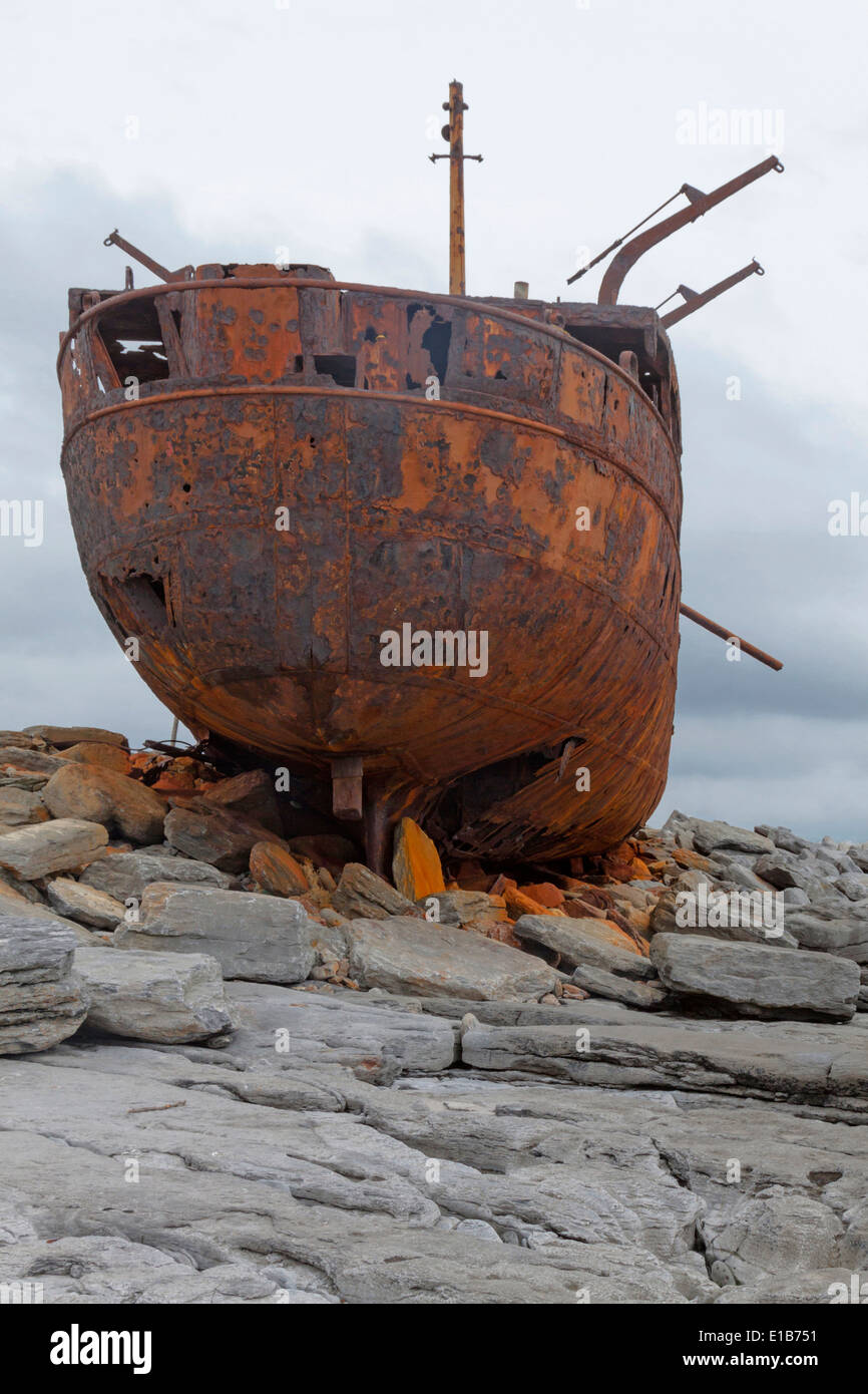 The rusty shipwreck of MV Plassey  on Finnis Rock, Inis Oirr or Inisheer, one of the three Aran Islands, West Ireland. Stock Photo