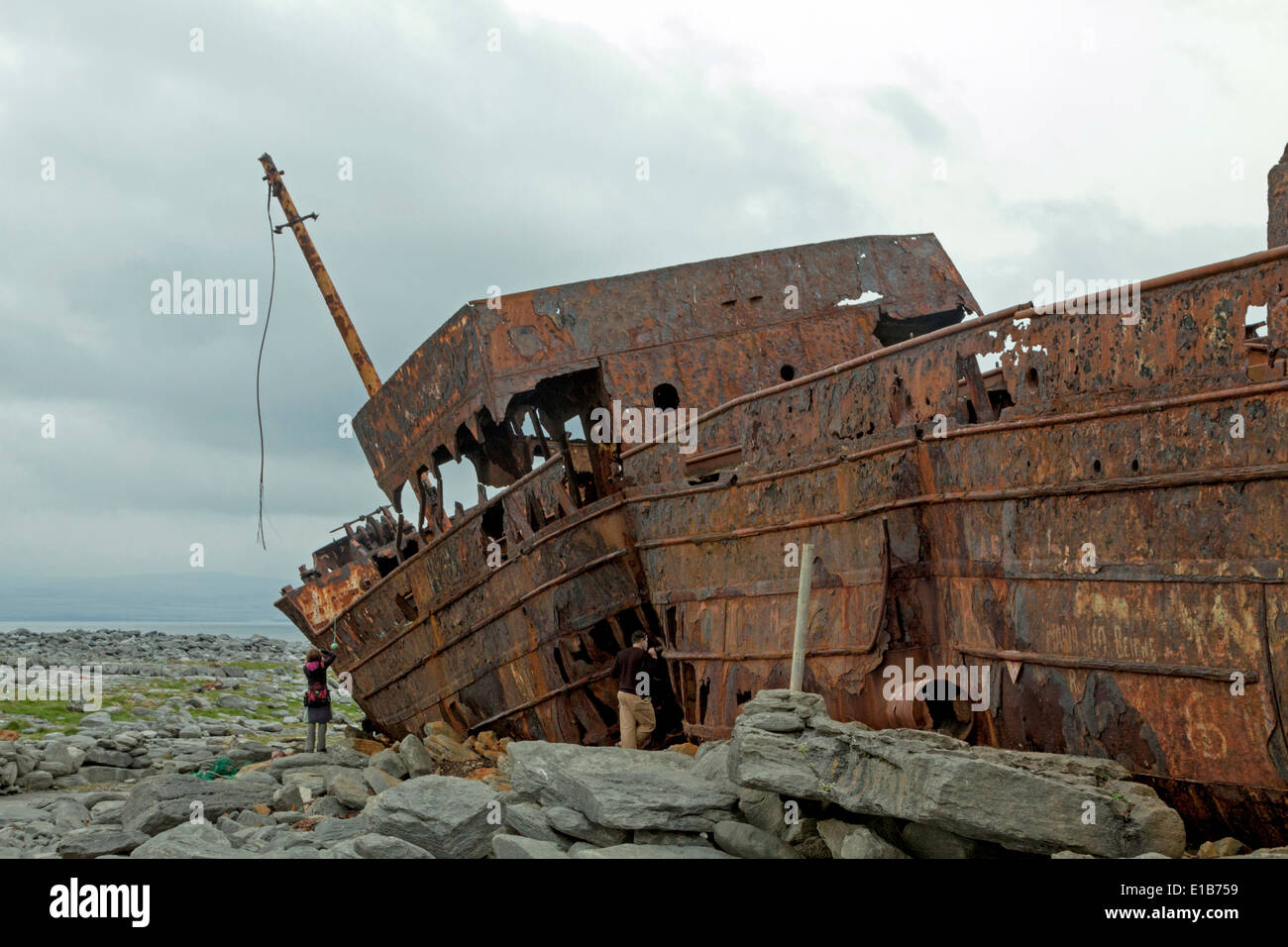 The rusty shipwreck of MV Plassey  on Finnis Rock, Inis Oirr or Inisheer, one of the three Aran Islands, Republic of Ireland. Stock Photo