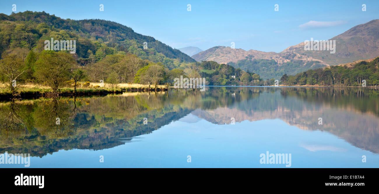 Reflections of Llyn Gwynant a lake in the valley of Nantgwynant at the heart of Snowdonia National Park Gwynedd North Wales UK, Stock Photo