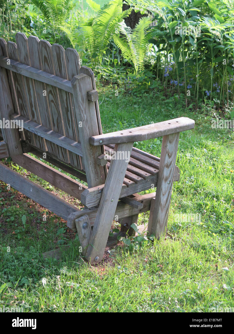 Outstanding Half Of A Wooden Swing Bench Is Visible In A Lush Garden Squirreltailoven Fun Painted Chair Ideas Images Squirreltailovenorg