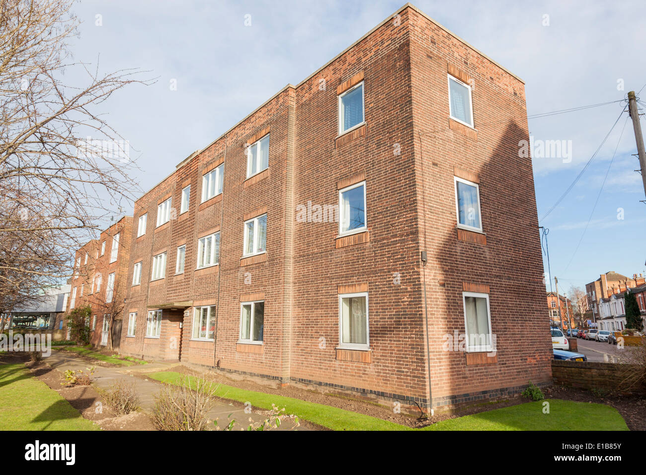 A low rise apartment block. A brick built building from ...