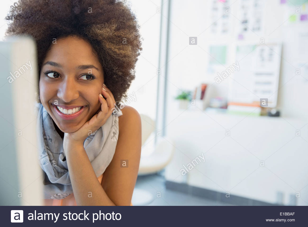 Smiling businesswoman in office - Stock Image