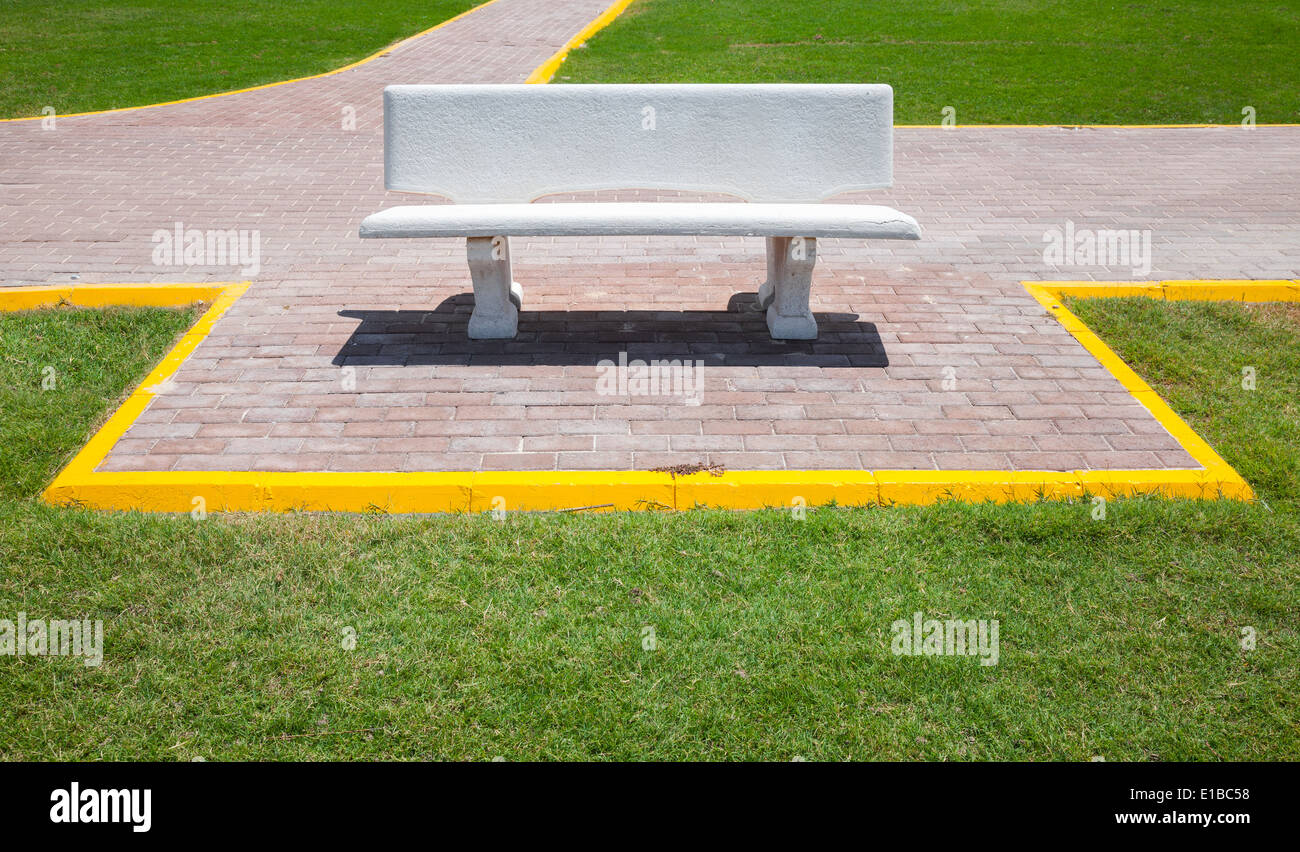 White empty bench in the summer park - Stock Image