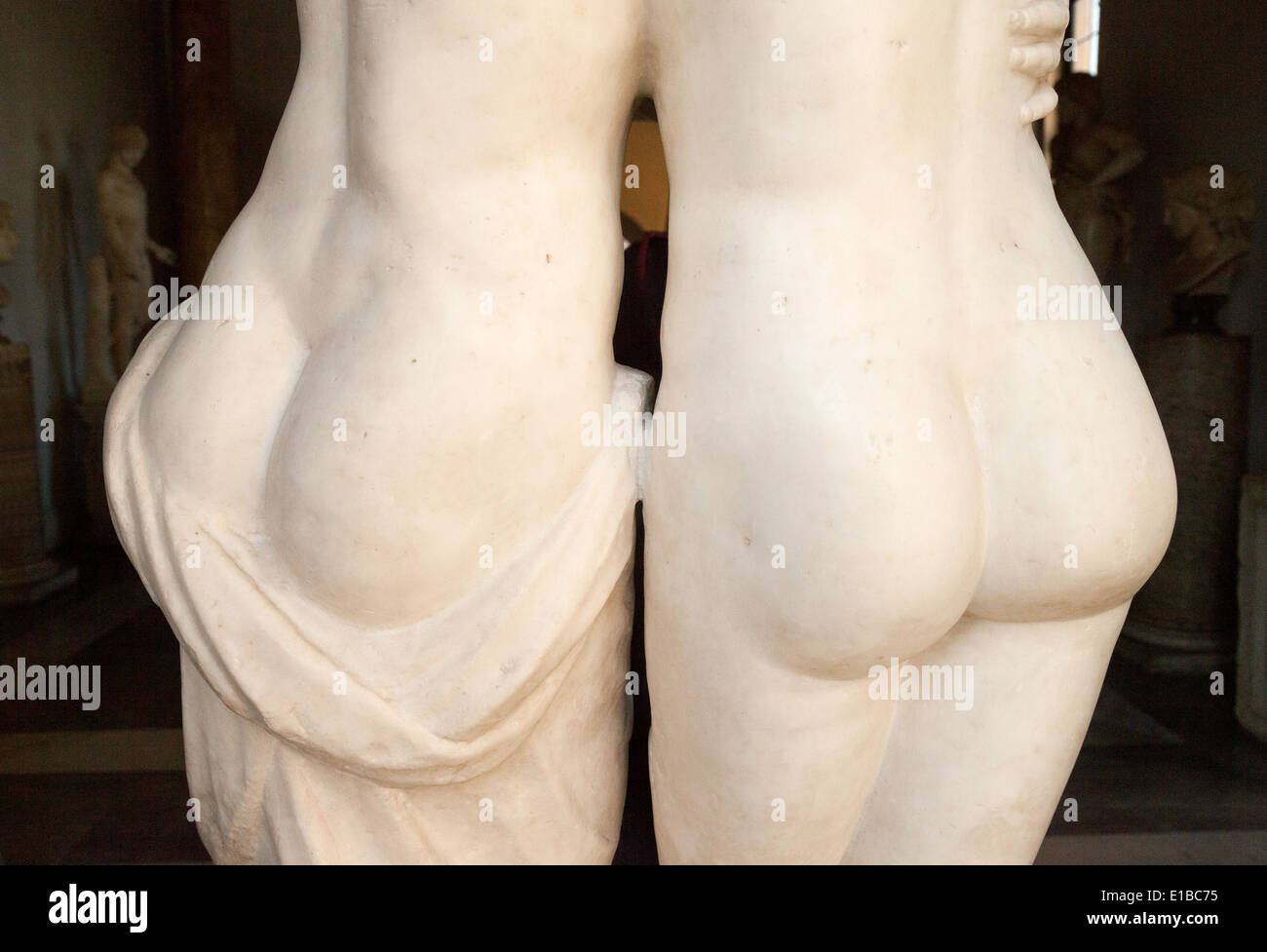 Rear view of the bottoms of two statues from ancient Rome, Musei Capitolini, Rome Italy Stock Photo
