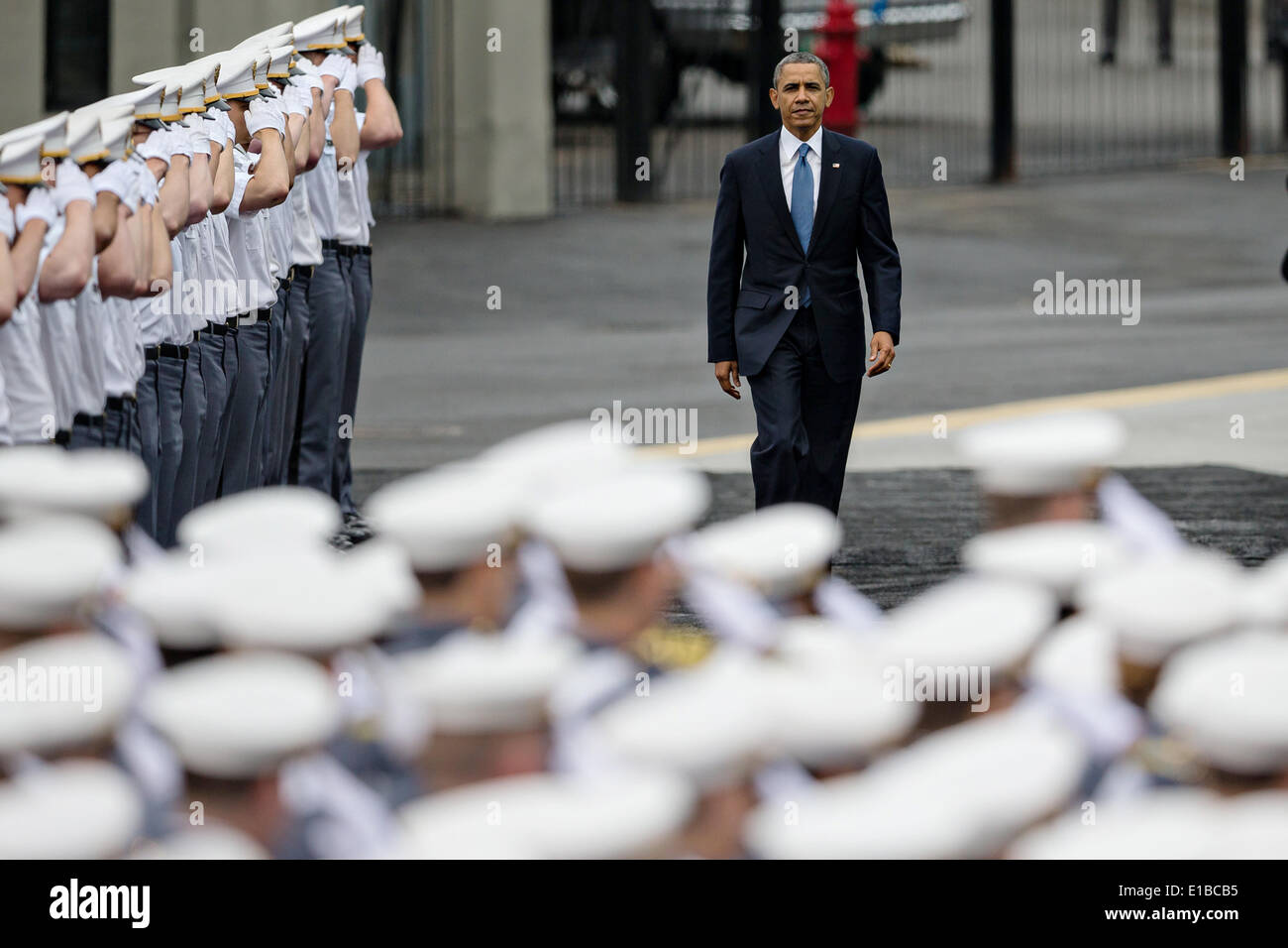 US President Barack Obama passes cadets as he enters Michie Stadium to give the commencement address during graduation - Stock Image