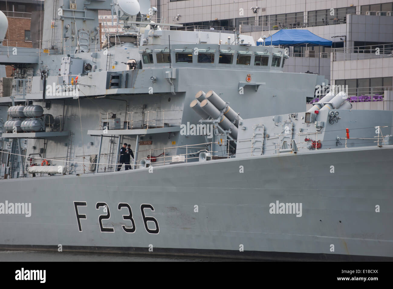 West India Dock, Isle of Dogs, London UK. 29th May 2014. HMS Montrose, Type 23 Duke class Frigate, berths among the offices of Canary Wharf in London as part of the 350th Anniversary of the Royal Marines. Montrose is normally based in Devonport. Credit:  Malcolm Park editorial/Alamy Live News Stock Photo