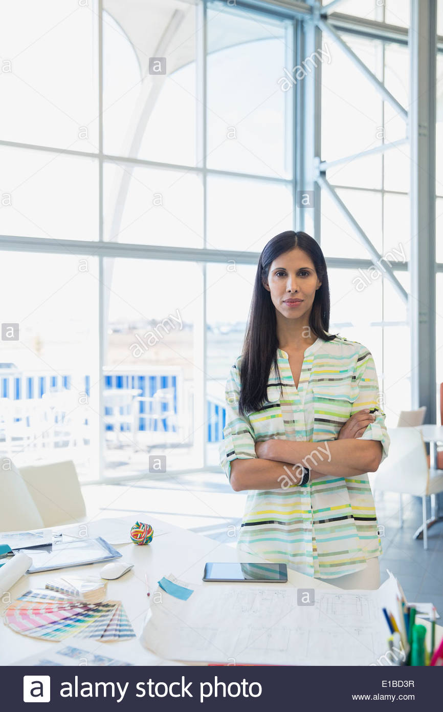 Portrait of creative businesswoman in office - Stock Image