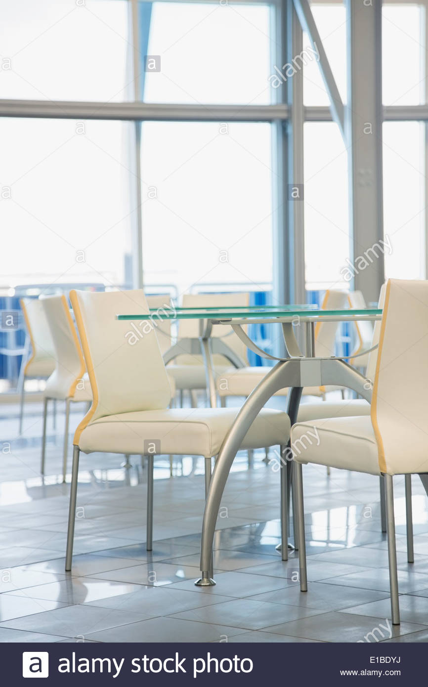Tables and chairs in empty office cafeteria - Stock Image