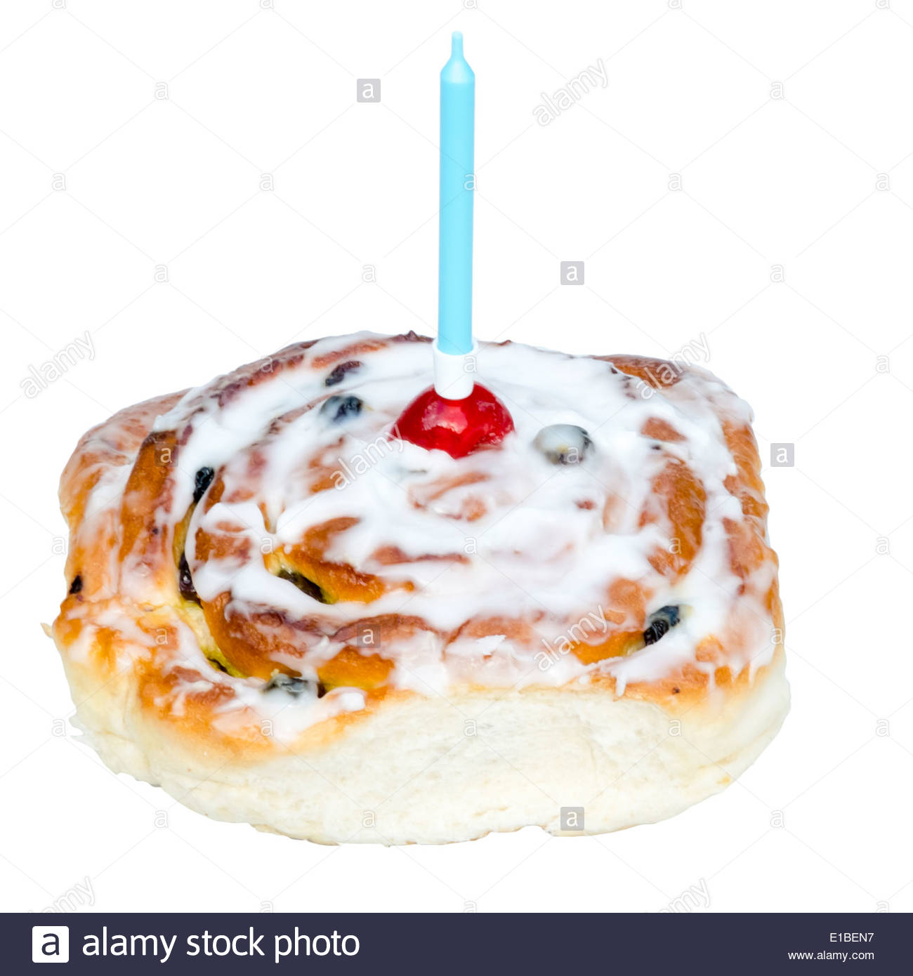 Belgian bun with a blue birthday candle. Iced bun with a cherry on top, isolated against a white background. - Stock Image
