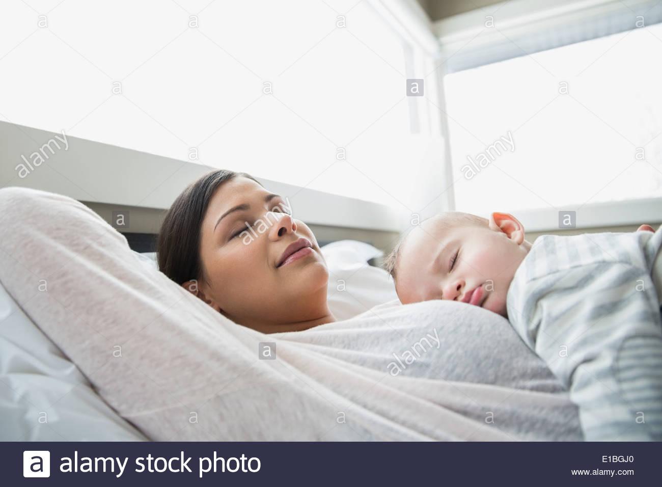 Serene mother and baby sleeping - Stock Image