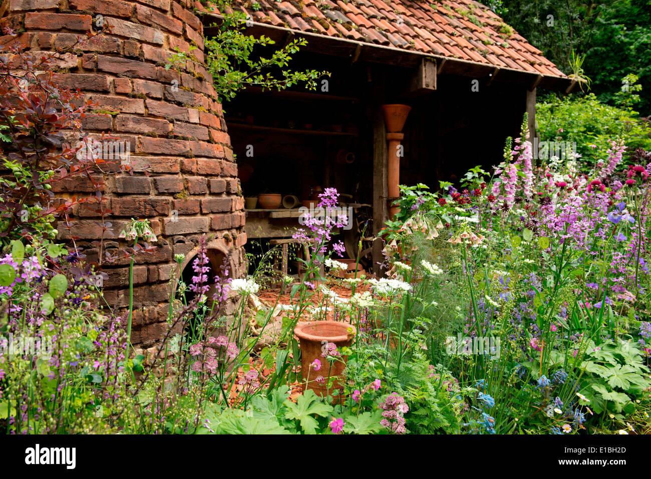 The DialAFlight Potter's Garden, an artisan garden gold medal winner at the Chelsea Flower Show 2014, London, UK - Stock Image