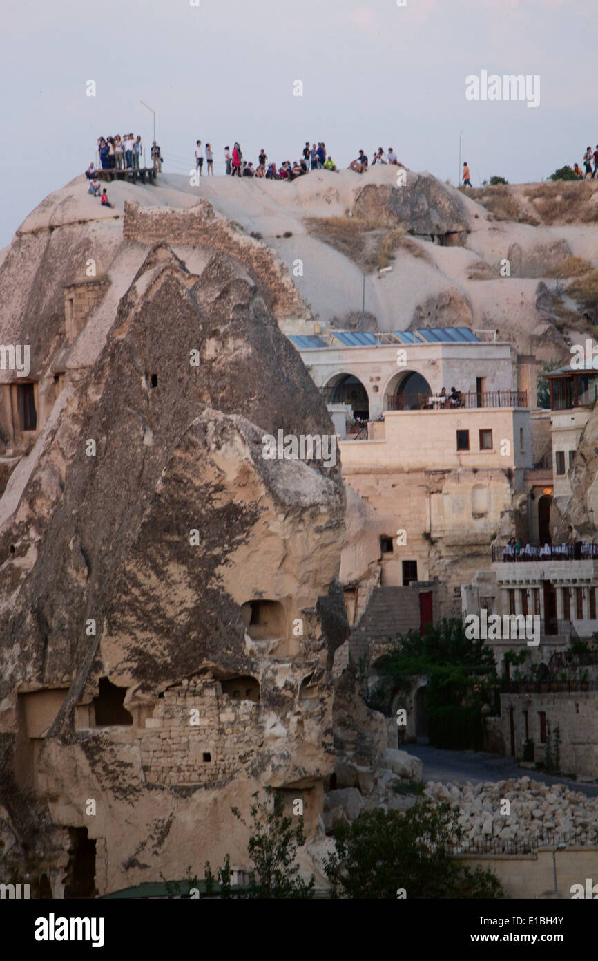 Turkey Cappadocia Anatolia Göreme People View Panorama Rock Viewpoint House Windows Walk Trekking Sunset Night Lights Buildings - Stock Image