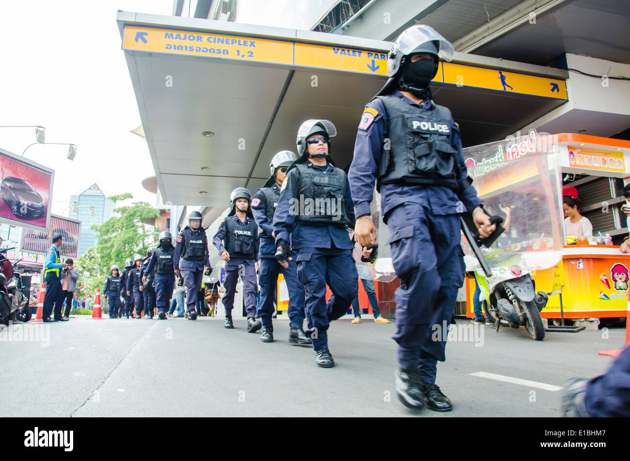 Riot police stand guard during a violent anti-Military coup. - Stock Image