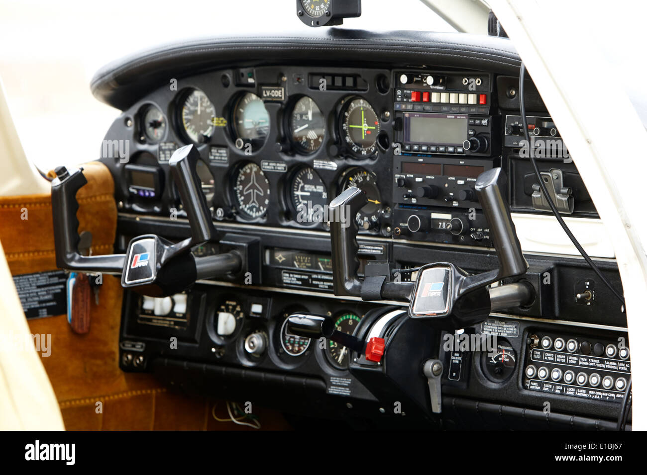 flight controls of a spanish language piper pa-28 archer light aircraft aeroclub Ushuaia Argentina - Stock Image