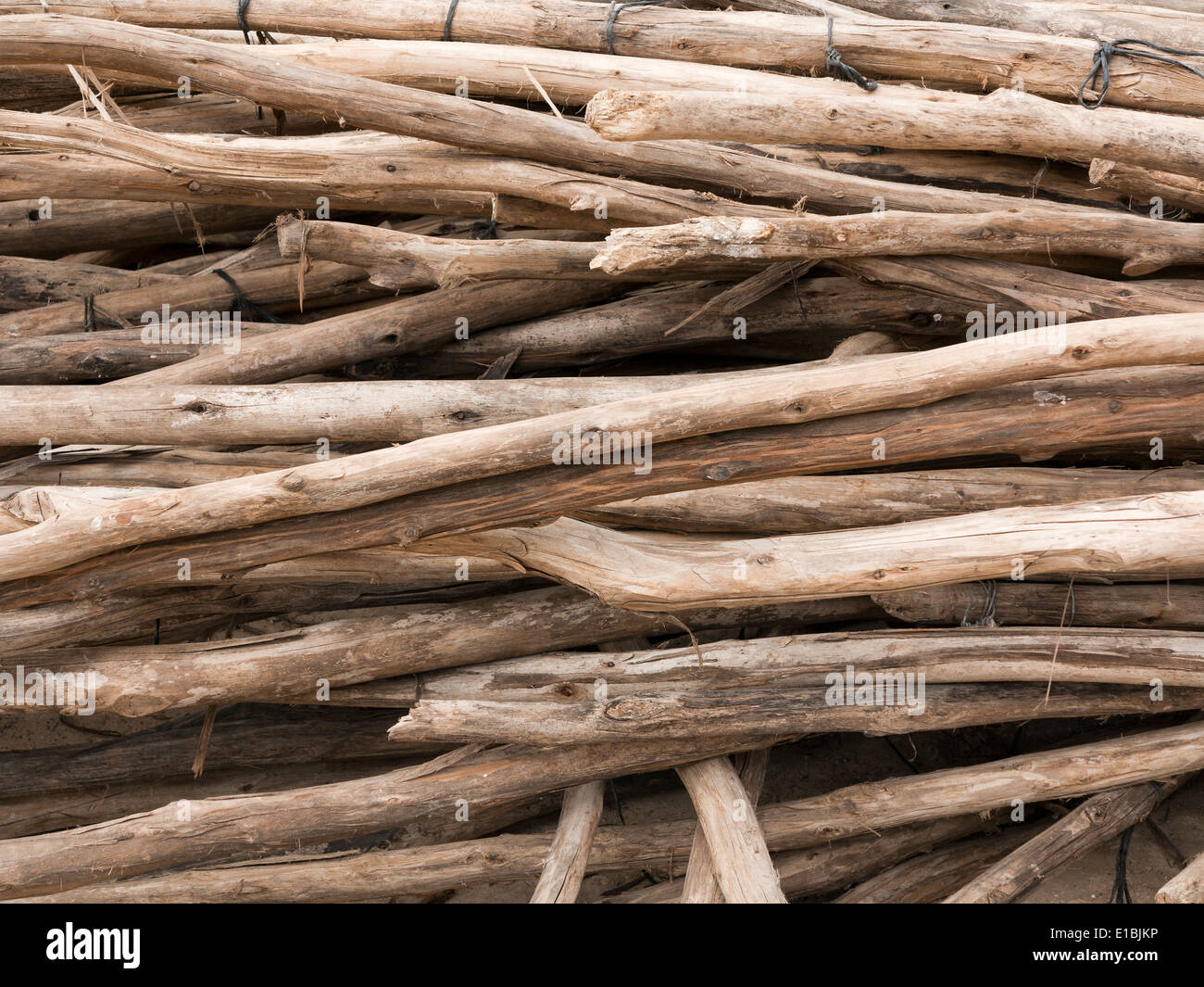 Close up of a pile of wooden props laying horizontally - Stock Image