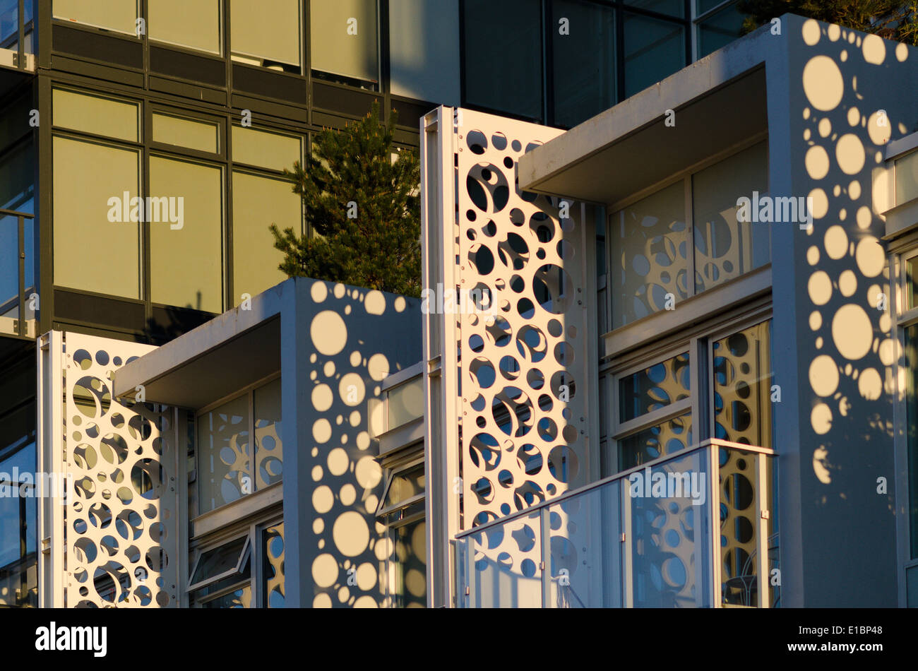 Condo apartments using circle holes as part of design - Stock Image