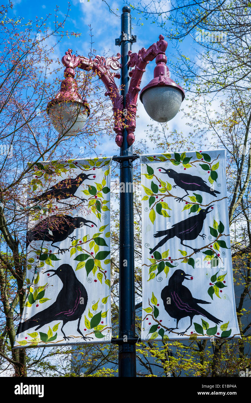 Hand painted Banners with crows, Vancouver, British Columbia, Canada - Stock Image