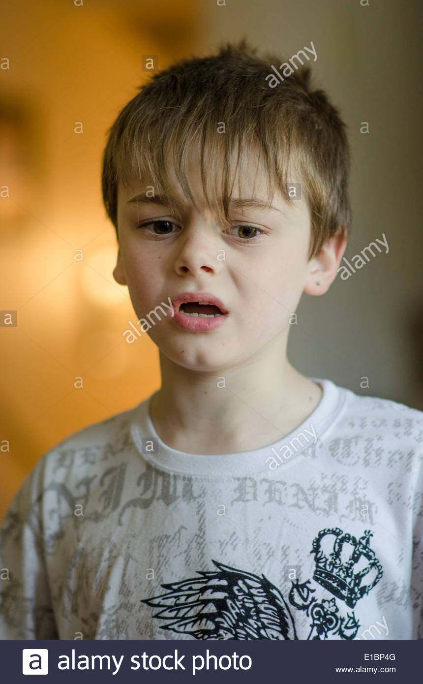 young boy with troubled face. - Stock Image