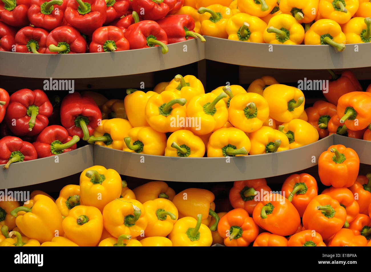 Several pods of varicolored sweet pepper, capsicum - Stock Image