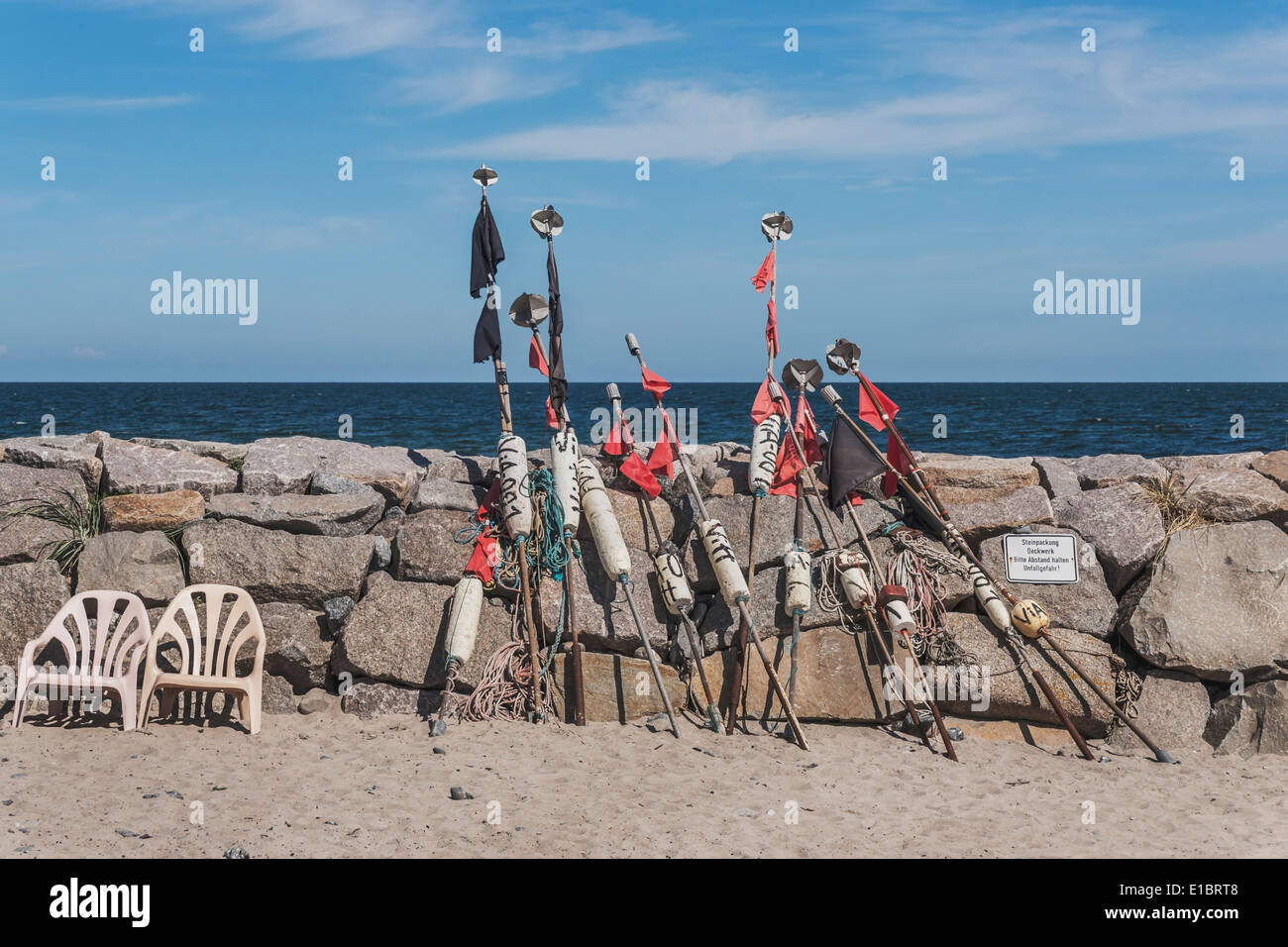 At the mole in the harbor of Vitt are buoys with red and black flags, Ruegen Island, Mecklenburg-Western Pomerania, Stock Photo