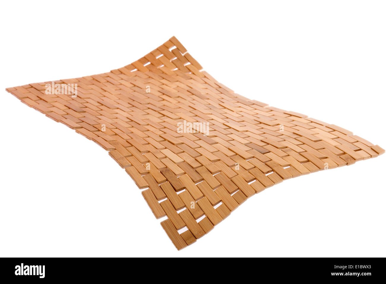Whirling bamboo mat floating in the air isolated on white with a diagonal perspective and corner bent down in the foreground sho - Stock Image
